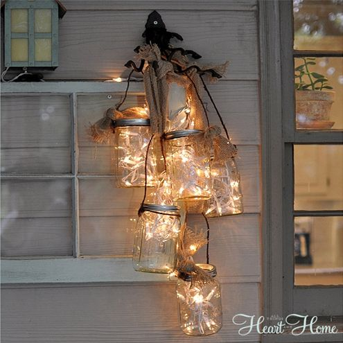Capture Some Light Here's a fun project you can DIY with some of your extra Christmas lights! Make hangers for several wide mouth Mason jars using some grapevine wire. Stuff your lights in, and then attach burlap ribbon to your wall fixture to create different lengths. Plug the lights in and you've got your very own Mason jar chandelier!