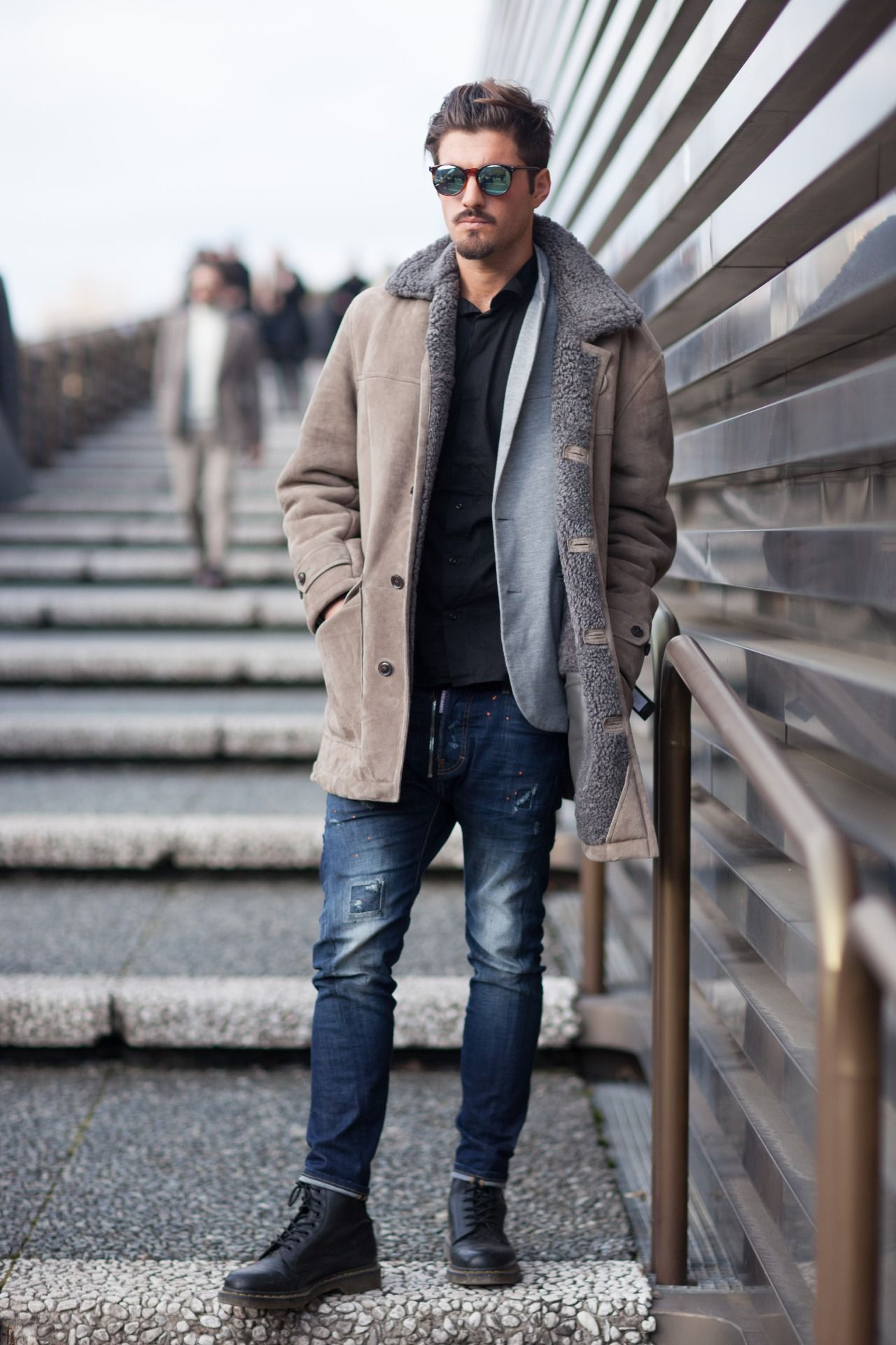 Smart casual outdoor styling with a soft blazer and classic shearling coat. WGSN street style at Pitti Uomo Subscribers click here for trends and full images galleries!
