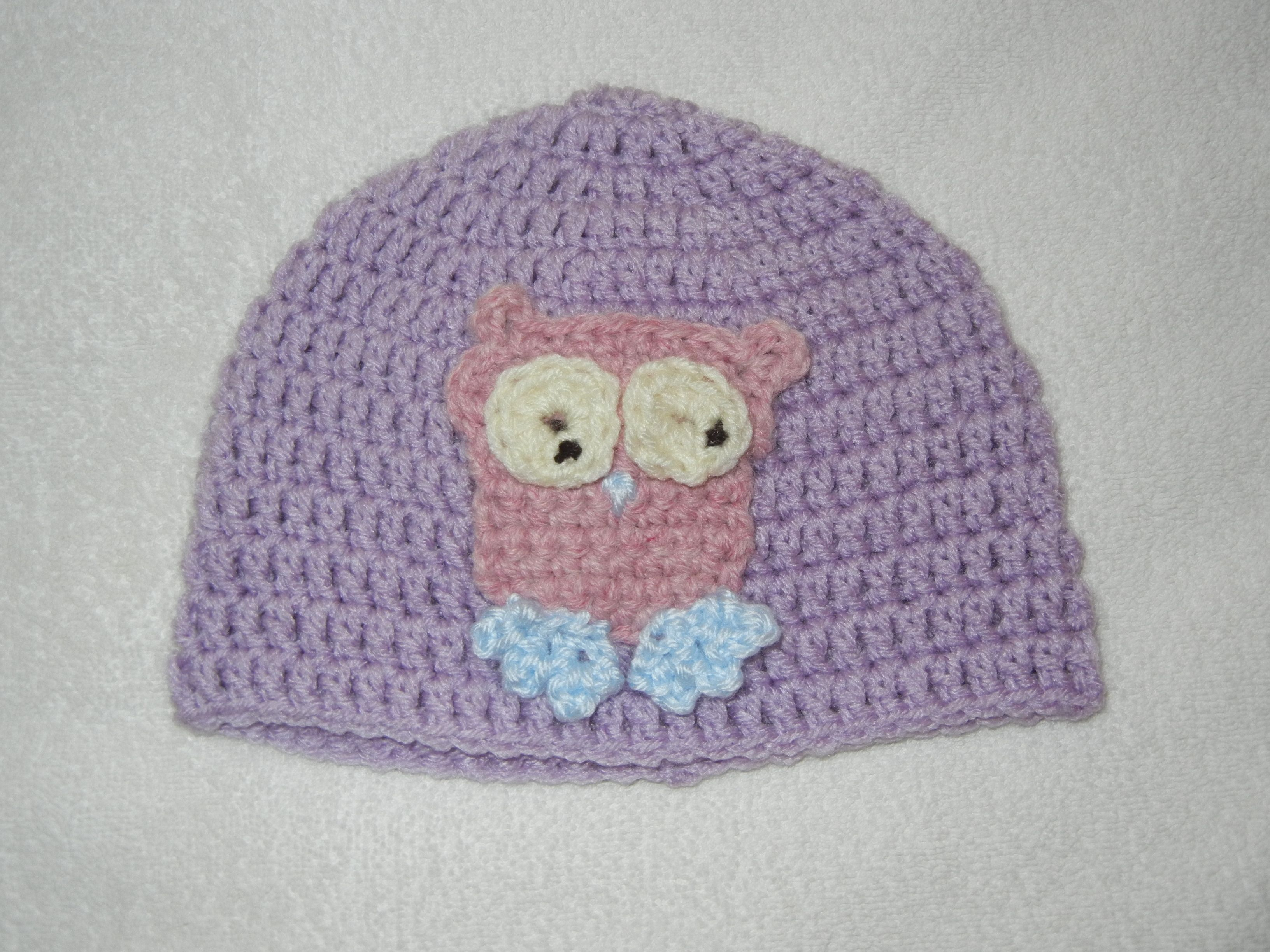 Purple baby hat with owl.