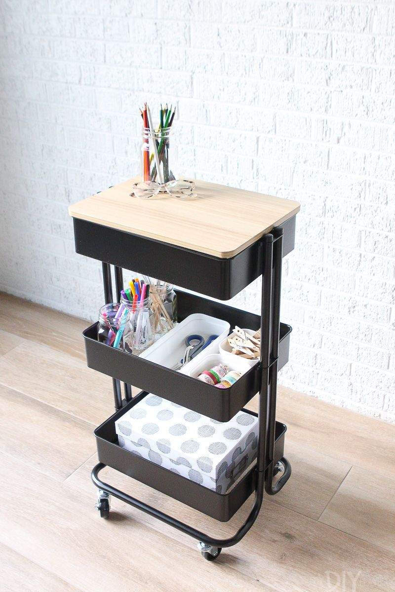 We take a simple rolling cart and give it 3 organized uses in the home. This is it all organized with craft supplies to keep them corralled and organized for a homework station or portable creative cart! #organized #rollingcart #craftsupplies