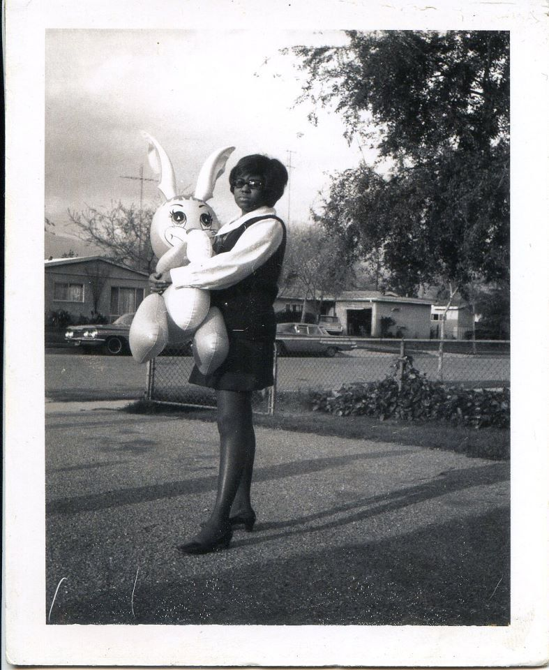 Vintage 60s snapshot. Girl with blow up rabbit, Easter.