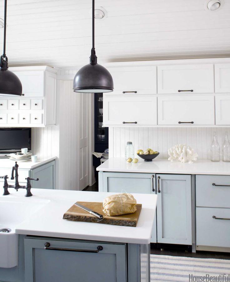 A blue and white farmhouse kitchen white farmhouse