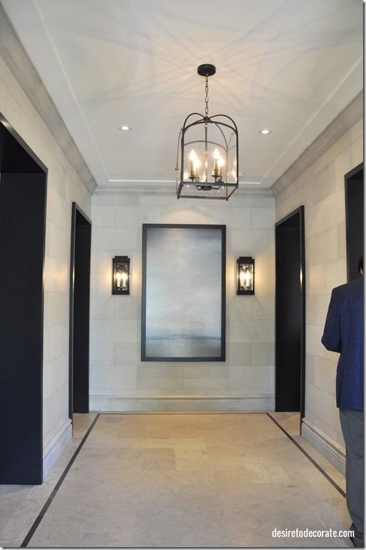 Home entryway reminiscent of a hotel lobby brian for Hotel foyer decor