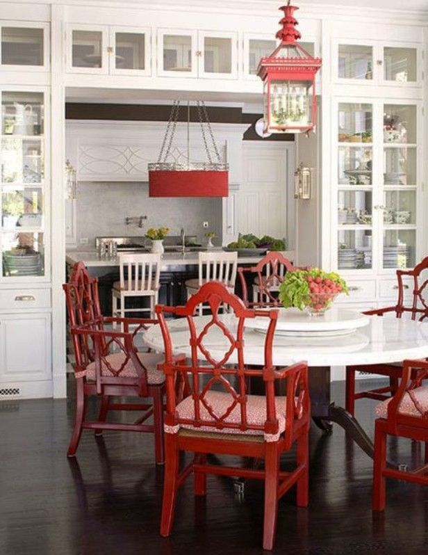 Red Lacquered Italian Armchairs And Hanging Pineapple Lantern Make The Black
