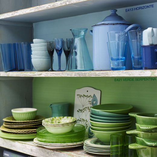 Shelving with green and blue crockery