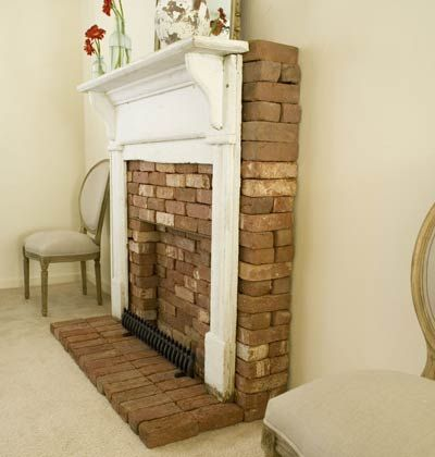 Create a focal point i love this idea faux fireplace for Small fake fireplace