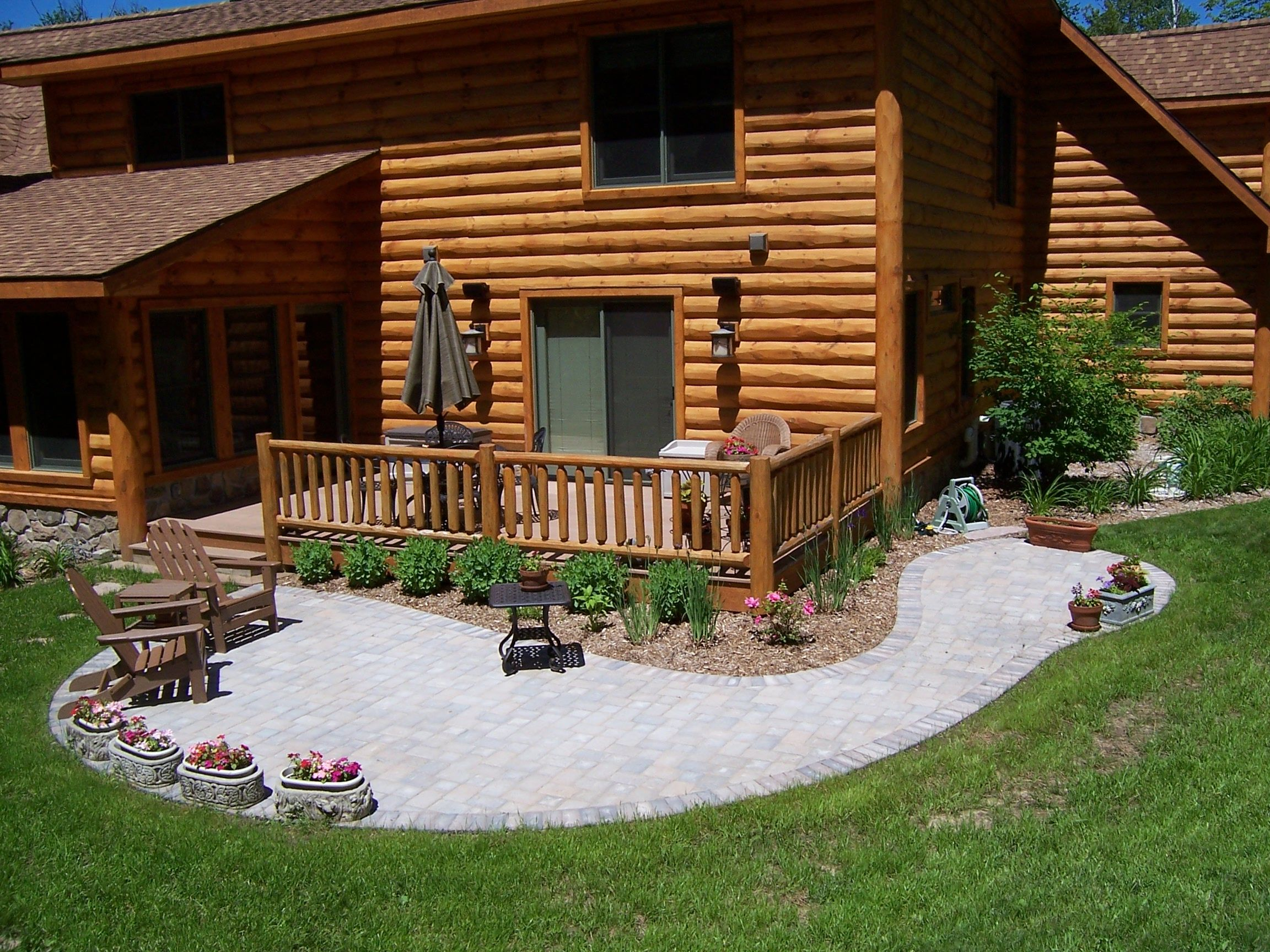 Back deck and paver patio with a log cabin home the vande for Log cabin porches and decks