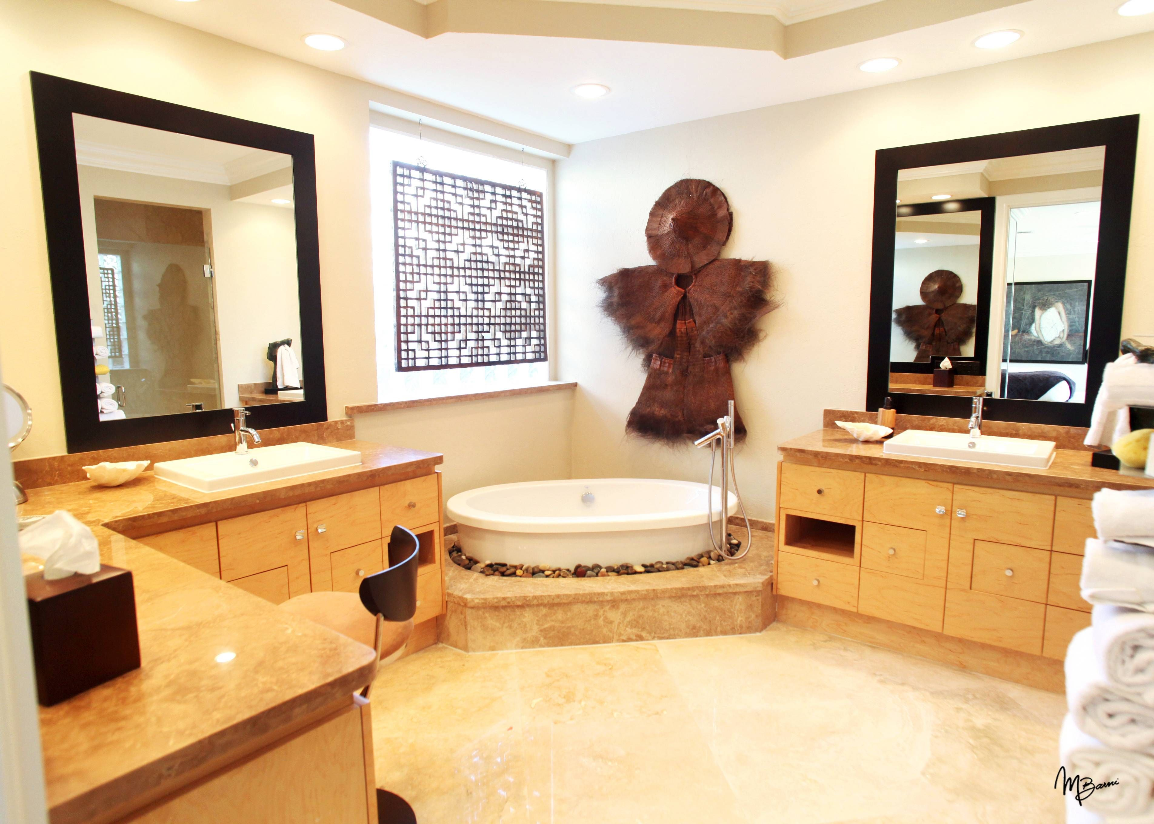 designer ron caster went further and supplement the custom bathroom cabinets with the innovative selection of accessories in a boca raton residence