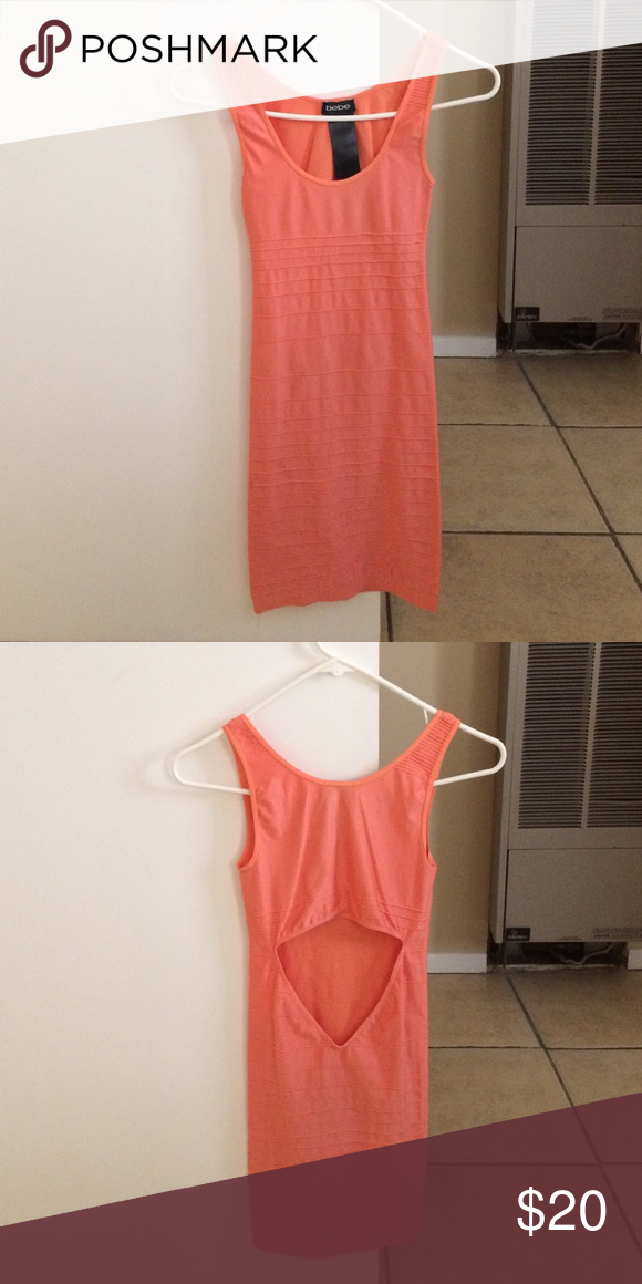 Coral dress Only worn once. Diamond designed cut on back. Great condition. bebe Dresses Midi