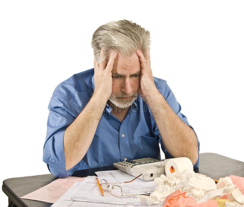 Tax Headache. Man with a tax headache and looking worried ...