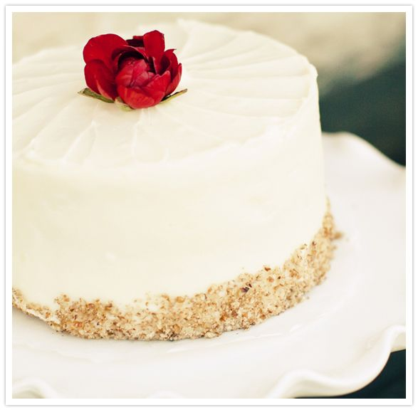 This simple white cake with red florals looks tasty