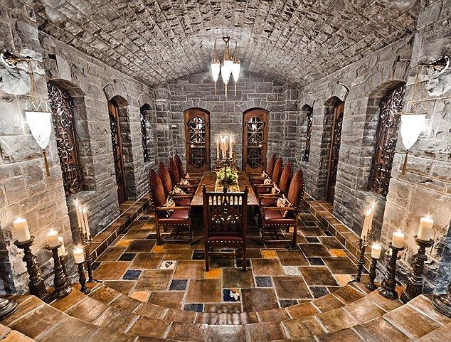 A Gothic Stone Walled Underground Dining Room Surrounded By Large Candlesticks In Celine