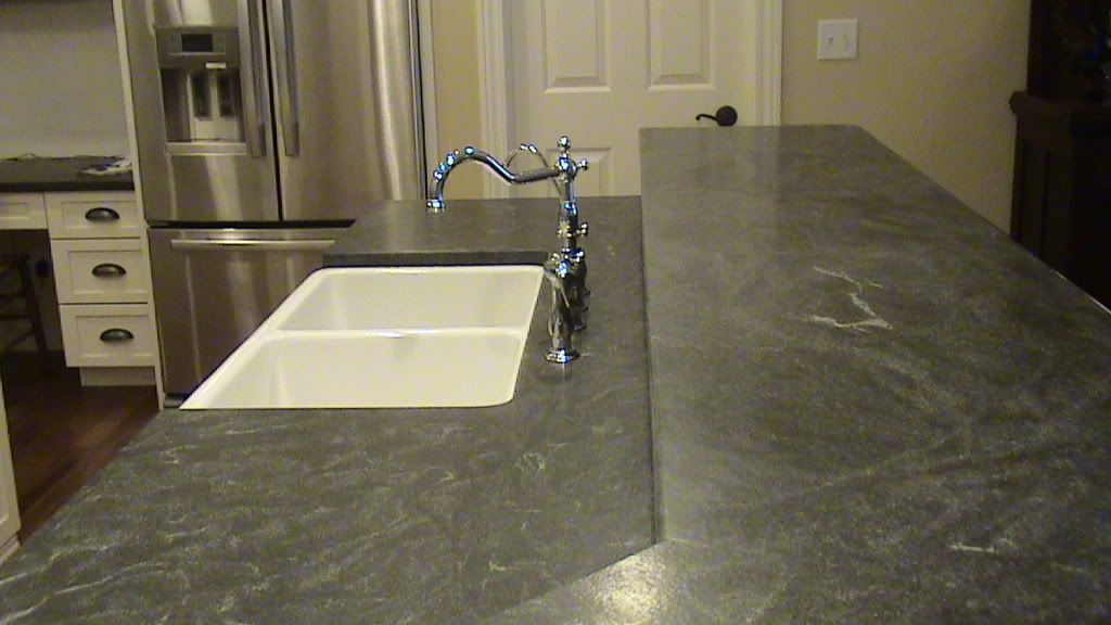 I M Really Liking Leathered Granite But Of Course It S One Of The Most Expensive Countertops Regrouping Leather Granite Granite Countertops Granite