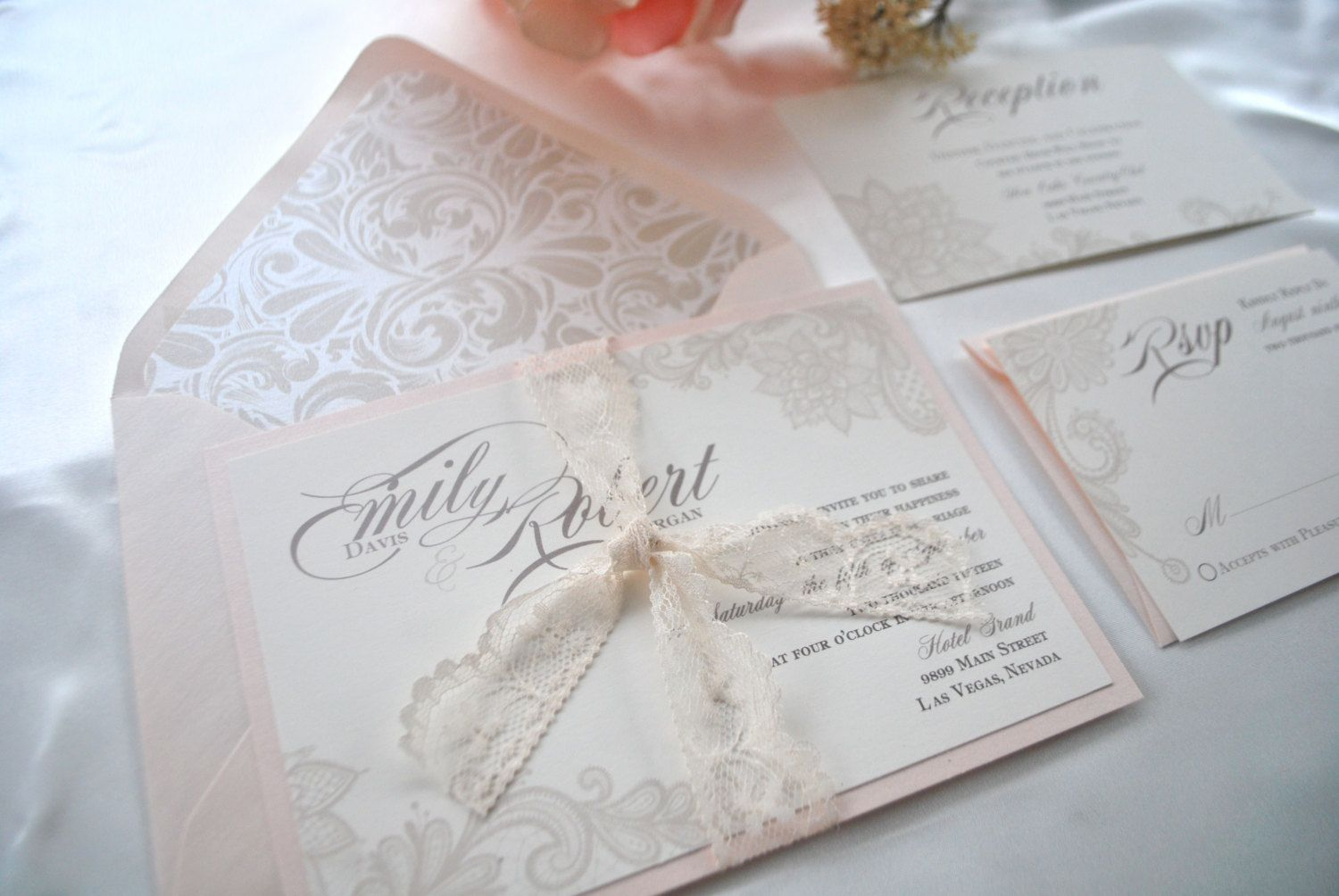 ***PLEASE DO NOT PURCHASE THIS LISTING *NOT A SAMPLE LISTING***  Perfect for any season, location and beautiful in any color theme. A delicate touch of romance and elegance will be the perfect touch for your lace theme.  Sample as seen- 5x7 Invitation is printed on Cream Cardstock and mounted on Metallic Blush cardstock. Invitation is wrapped with an Ivory lace ribbon. Metallic Blush envelope is lined in a mist color flourish pattern in metallic quartz paper. Rsvp card is printed on cream…
