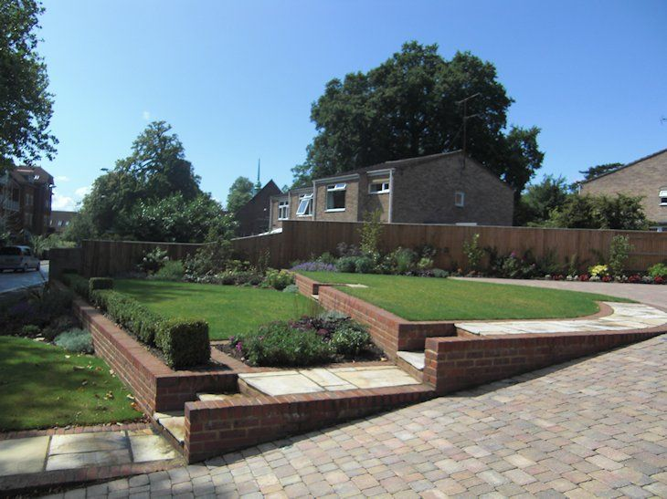 Large Sloping Front Garden Design In Woking Surrey With Terraced Levels Steps Up F Front Yard Garden Design Front Garden Ideas Driveway Front Garden Design