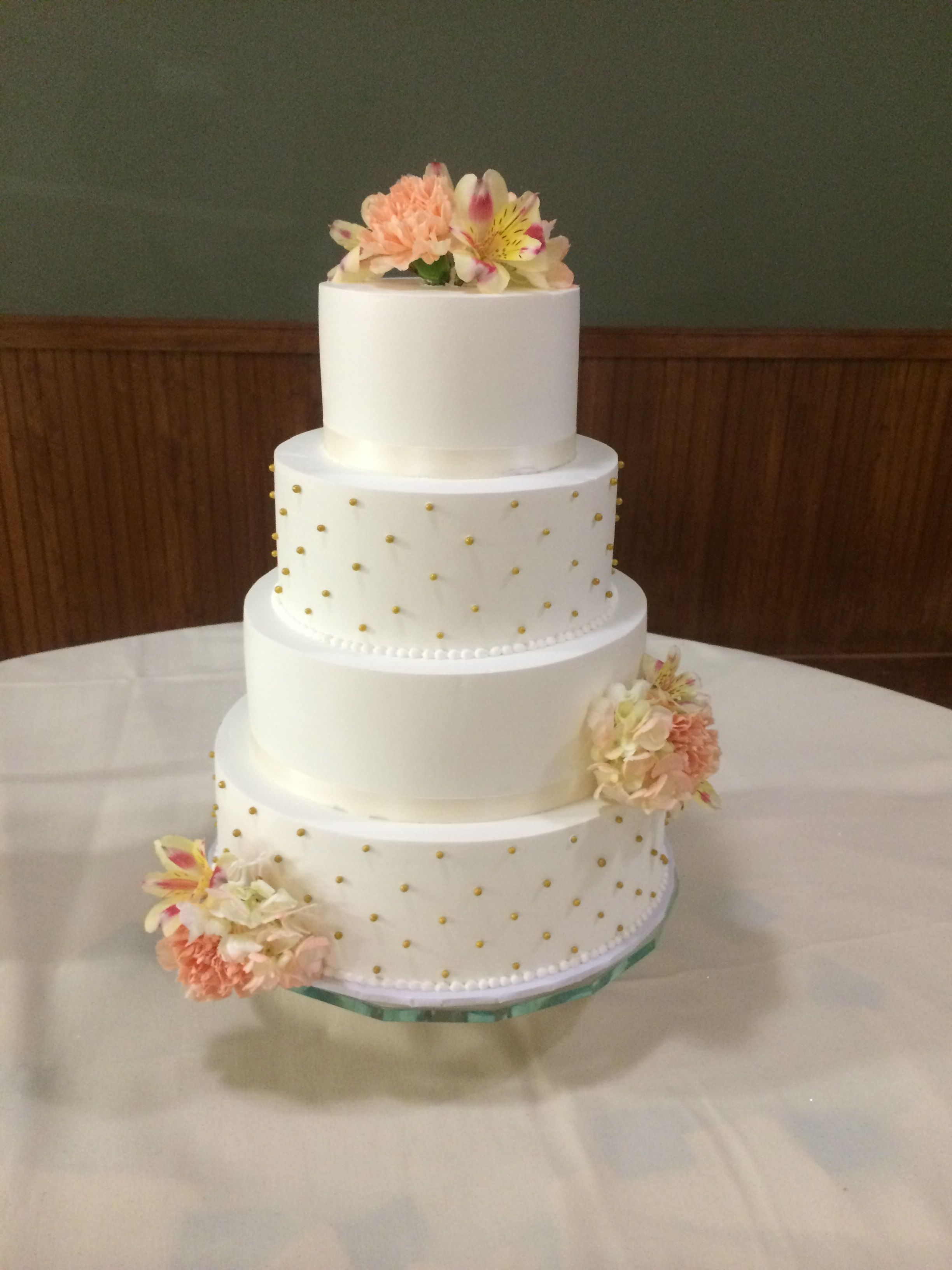 White 4 Tier Wedding Cake With Orange And Pink Flowers