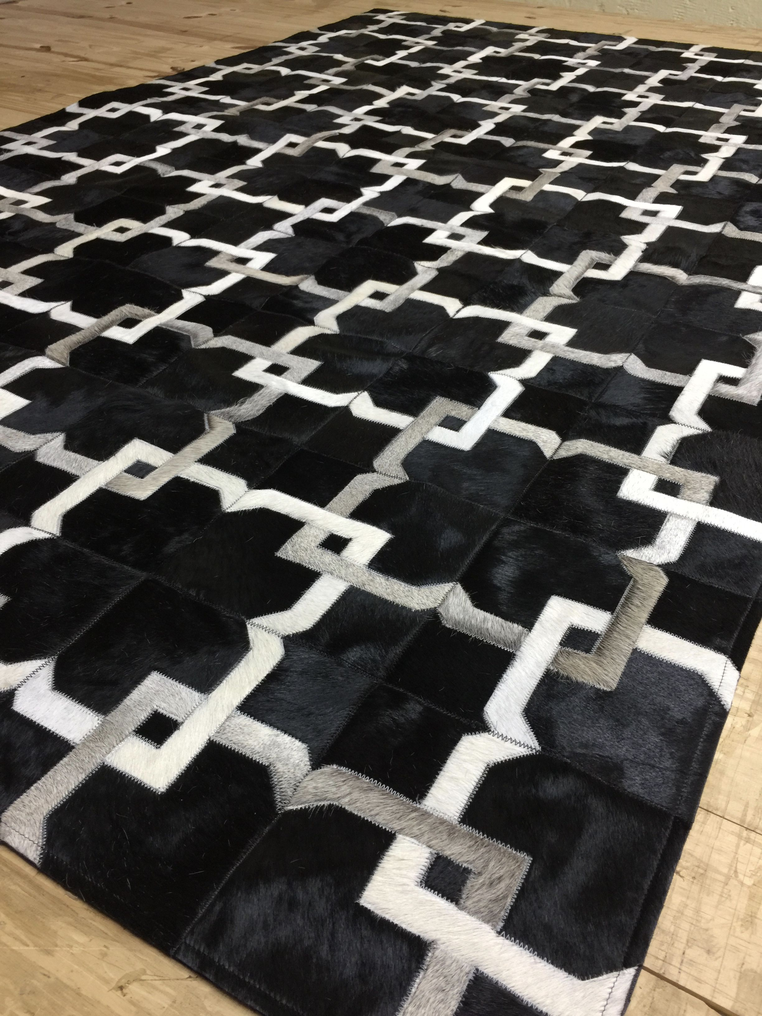 Blackcowhiderug Our Alvear Cowhide Patchwork Rug In Black Off White Grey