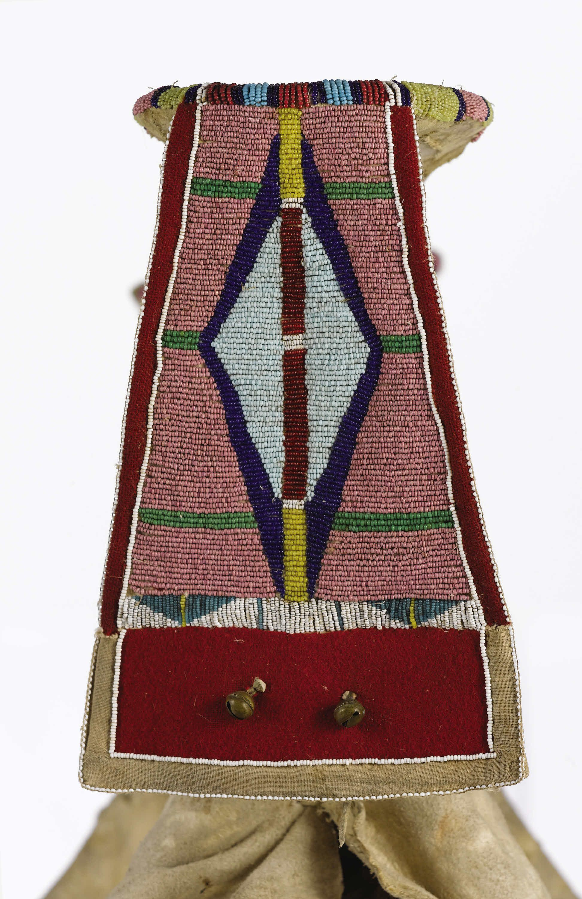 A CROW WOMAN'S BEADED HIDE PARADE SADDLE. c. 1890