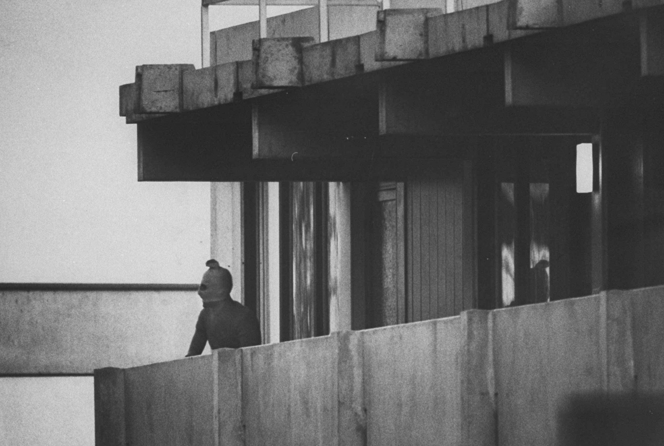 "<b>1972</b> | A masked Palestinian terrorist looks out from a balcony of the athletes' housing complex during the Munich Summer Olympics. On September 5, eight Palestinian guerrillas took 11 Israeli athletes and coaches hostage, and subsequently murdered all of them, in what came to be known as the ""Munich Massacre"" — the most infamous and violent outrage in Olympic history. Originally published in the September 15,1972, issue of LIFE."