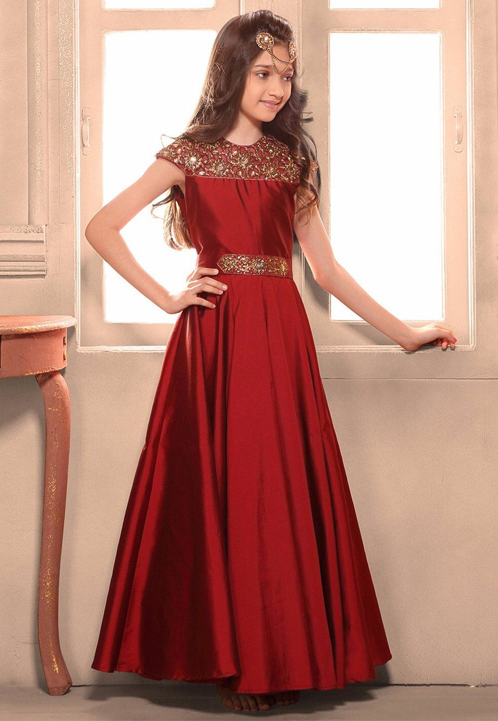 Hand embroidered art silk gown in maroon stylish creation