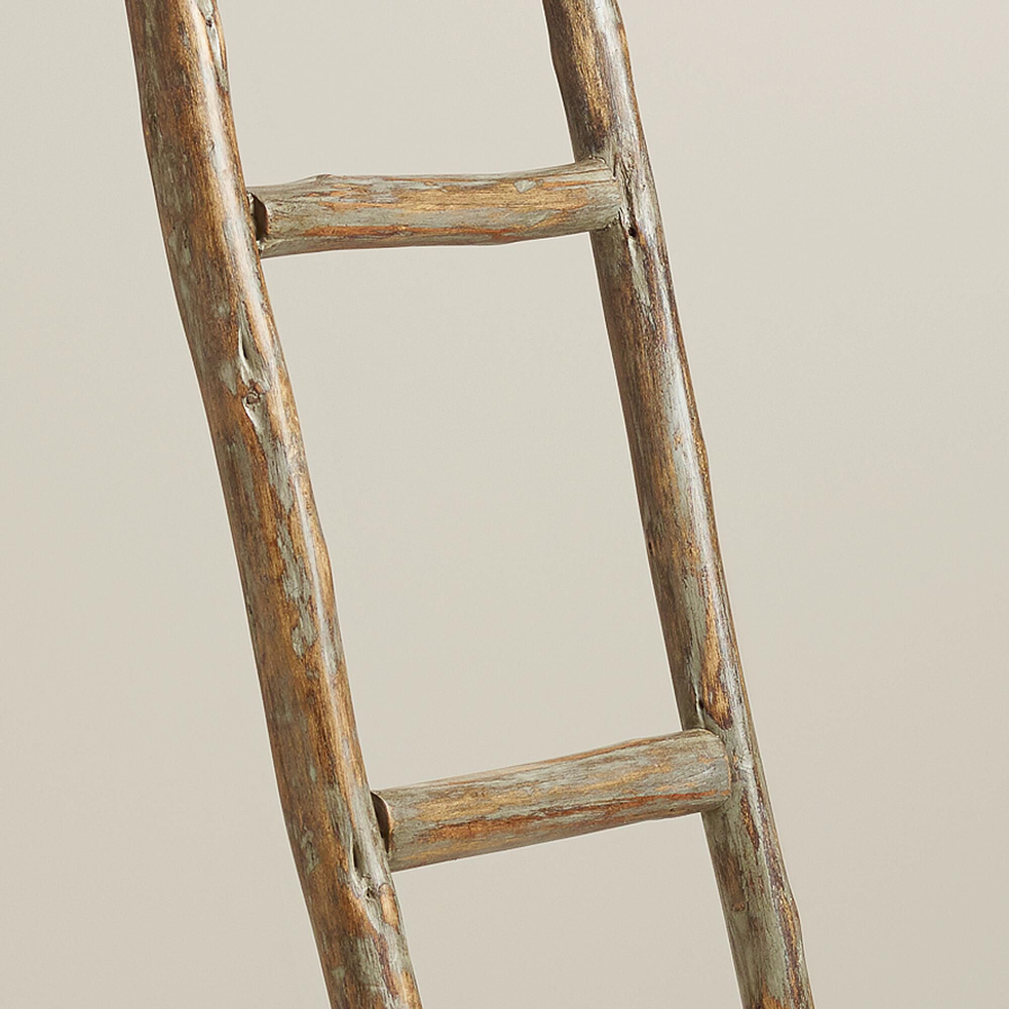 Crafted of wood this decorative ladder adds interest to any room