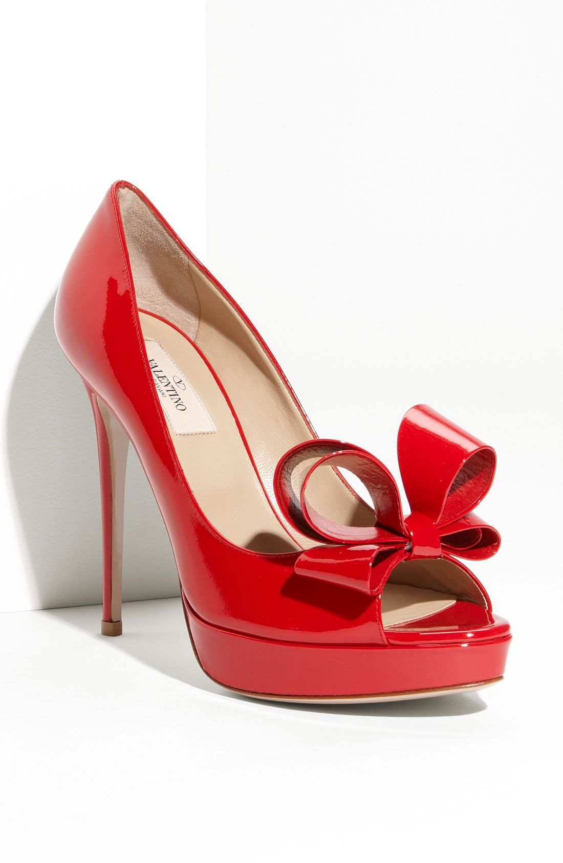 6c734775492 Head over heels for these gorgeous Valentino bow platform pumps ...