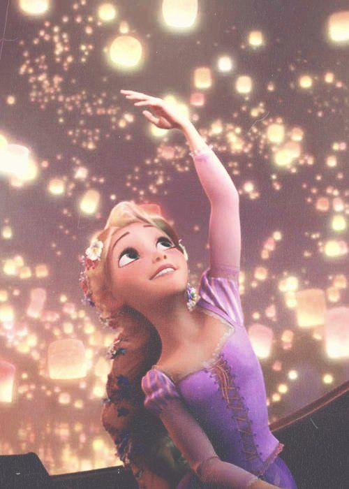 rapunzel,linda e tentando pegar as lanternas brilhantes