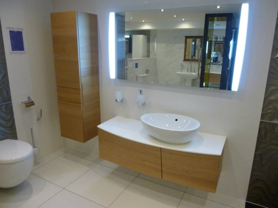 Bathroom Mirrors Newmarket aveo basin on glass and wood vanity unit. mirror, and wall hung wc
