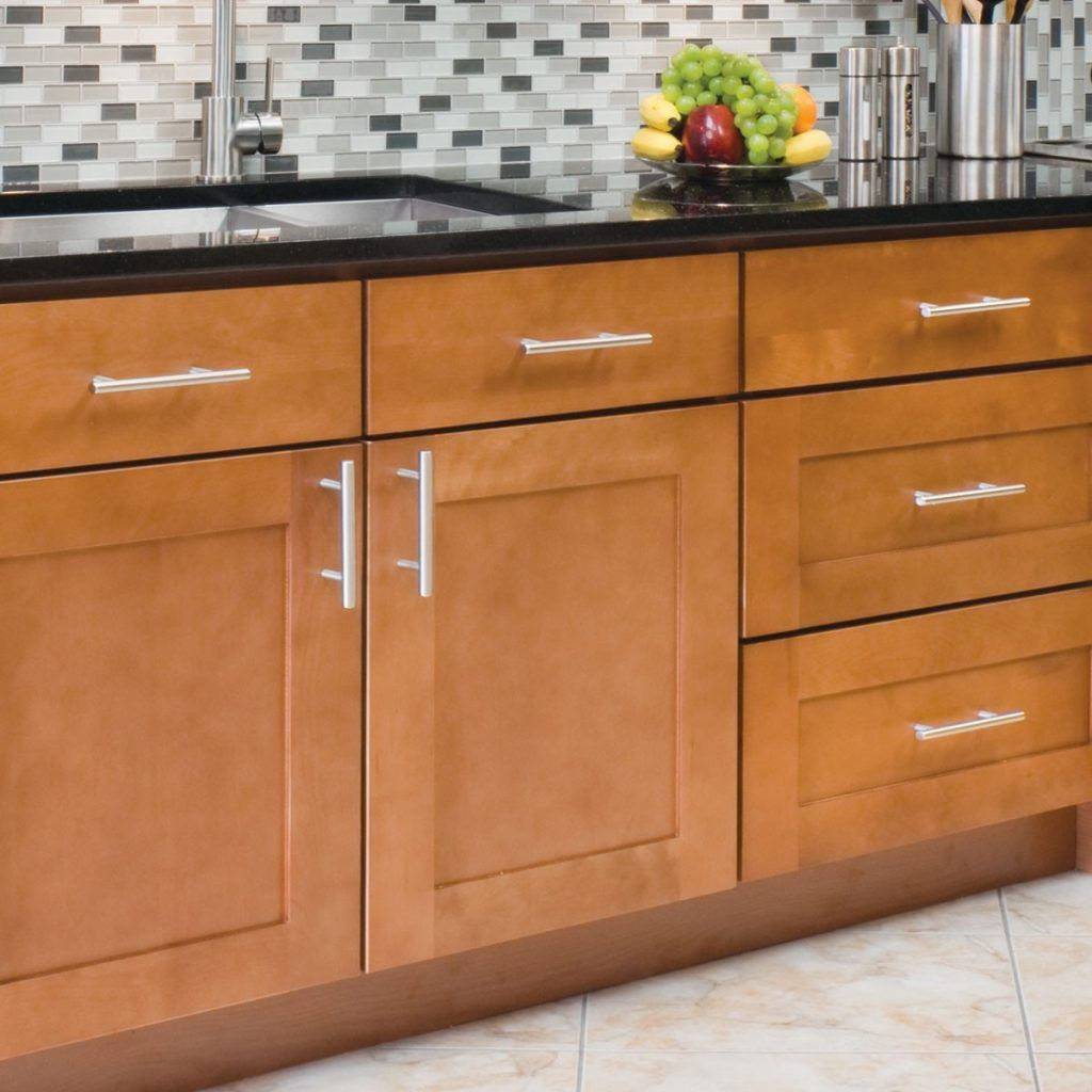 Kitchen cabinet with long stainless steel handles, closeup | home ...