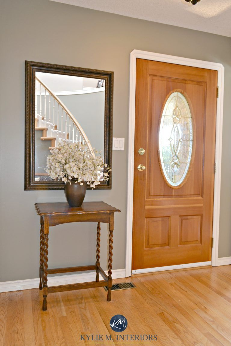 Benjamin moore sandy hook gray in entryway with orange toned oak floor and fir front door