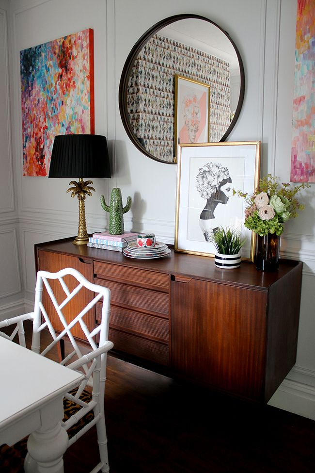 Mid Century Sideboard With Palm Tree Lamp Round Mirror And Abstract Art See More On Www Sw Sideboard Decor Dining Room Mirror Dining Room Modern Dining Room