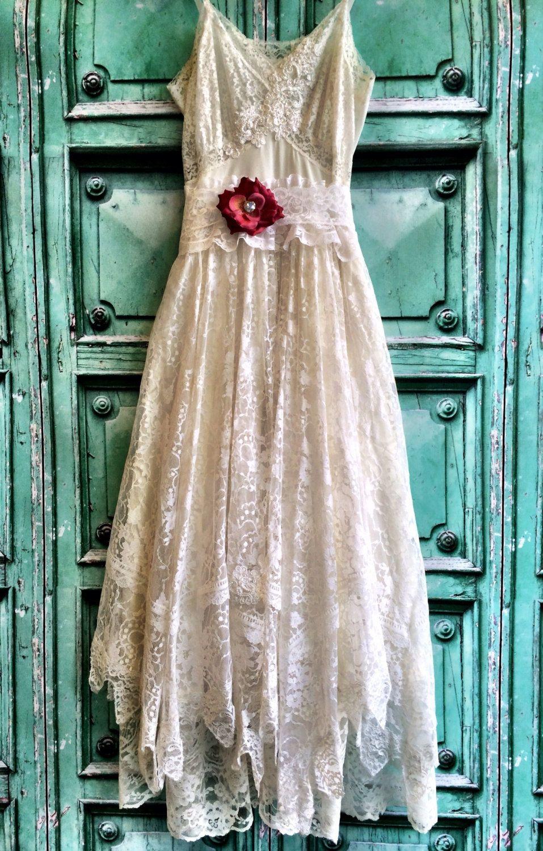 White & ivory lace handkerchief hem boho wedding dress by