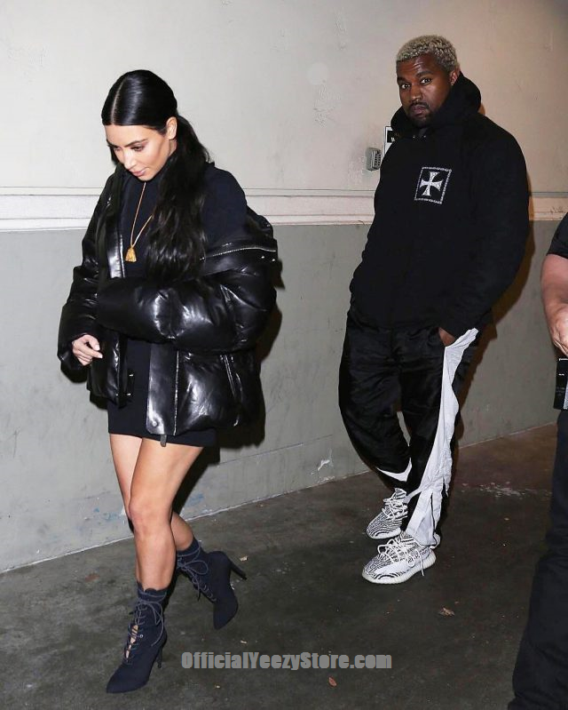 c00b6aa75 Kanye West With Kim Kardashian Wearing Enfants Riches Deprimes Hoodie and  Adidas Yeezy Boost 350 V2 Sneakers