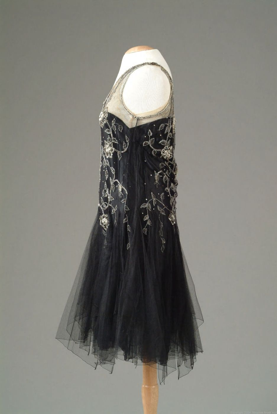 gown of black netting with seed pearl and rhinestone embroidery