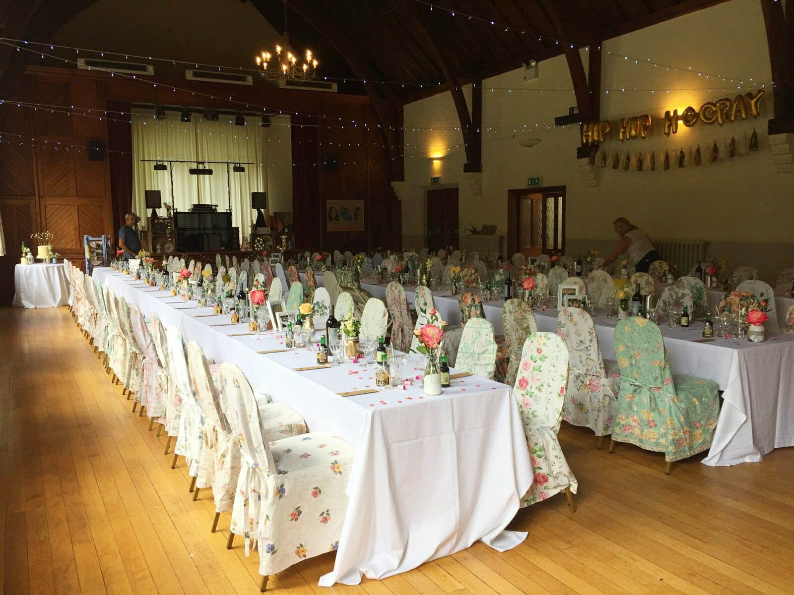 Betty Loves Vintage Vintage Floral Chair Covers All Lined Up In Rows At A Beautiful Village Hall Weddin Chair Covers Wedding Floral Chair Village Hall Wedding