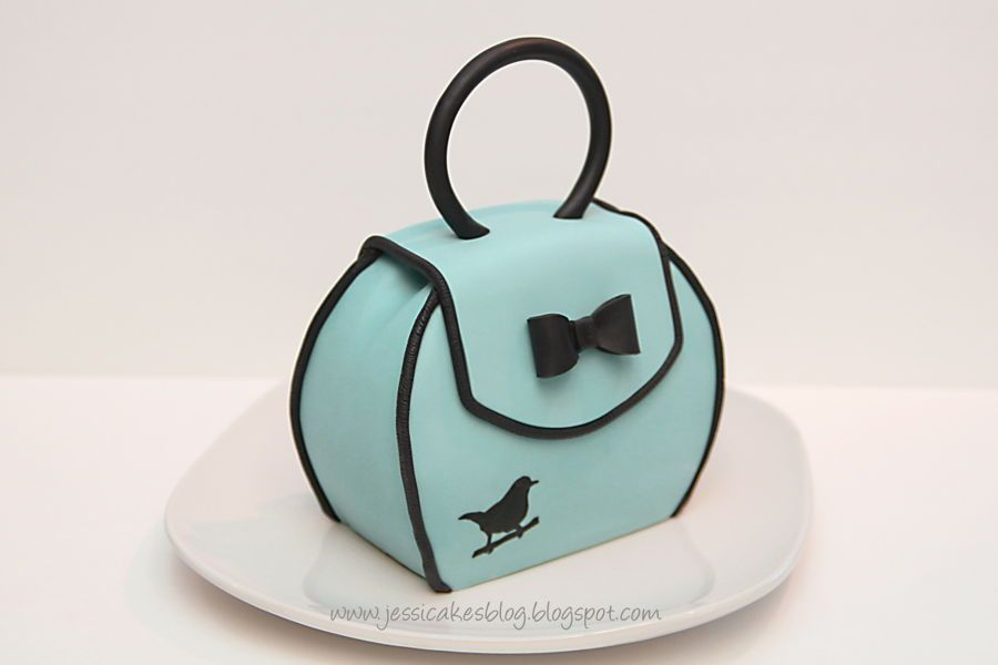 This is a tutorial for a small purse cake made from three 6″ round tiers.  Each tier is about 3 4″ thick making the.