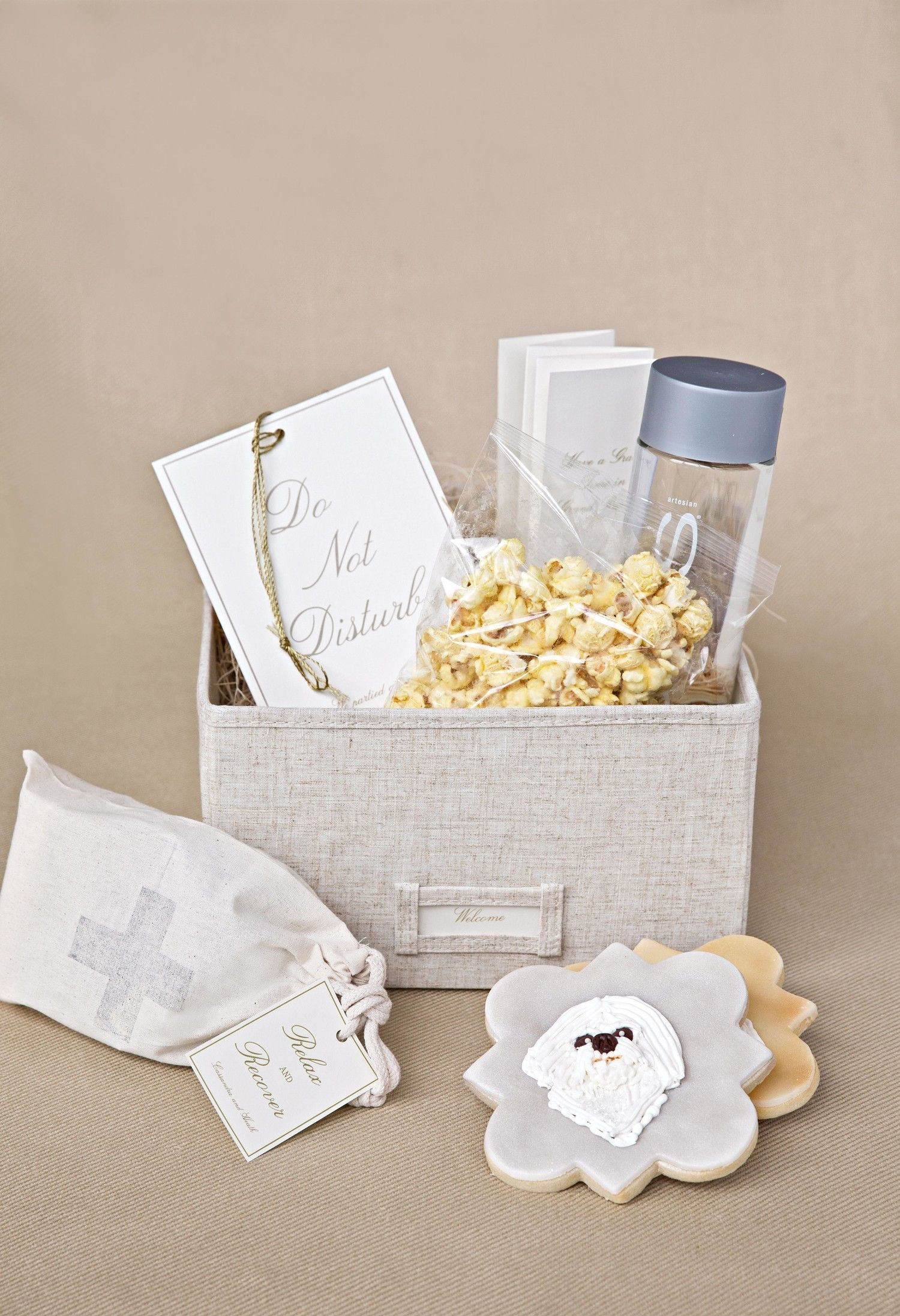 Welcome boxes are always better with snacks. These newlyweds opted ...