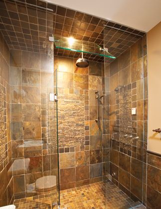 A frameless shower can take up less space in a small bathroom ...