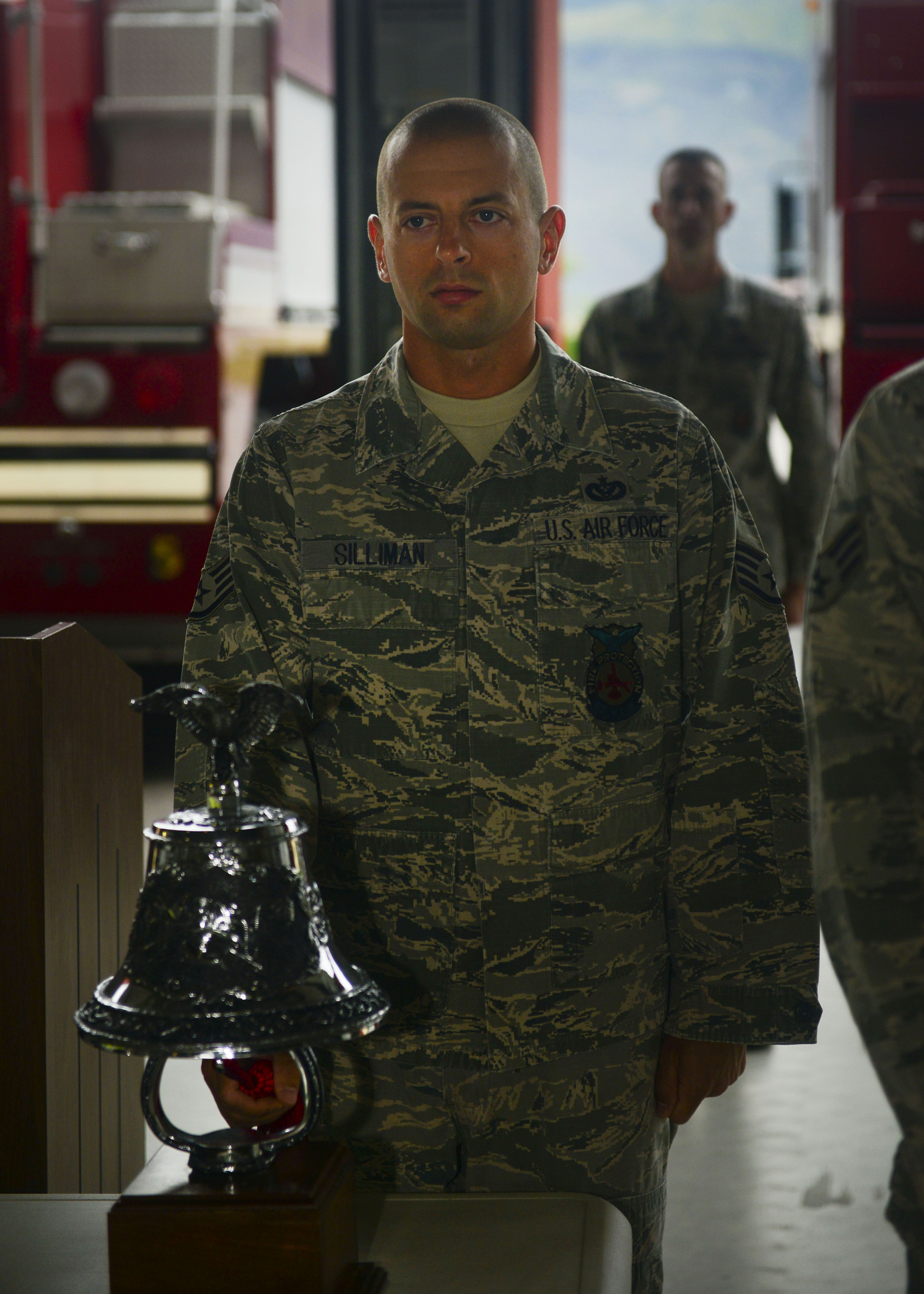 Staff Sgt. Matthew Silliman, 31st Civil Engineer Squadron firefighter, rings the last alarm during a 9/11 Remembrance Ceremony Sept. 11, 2013, at Aviano Air Base, Italy. The last alarm is a tradition of the fire service that honors those who gave their lives in the line of duty. (U.S. Air Force photo/Staff Sgt. Evelyn Chavez)