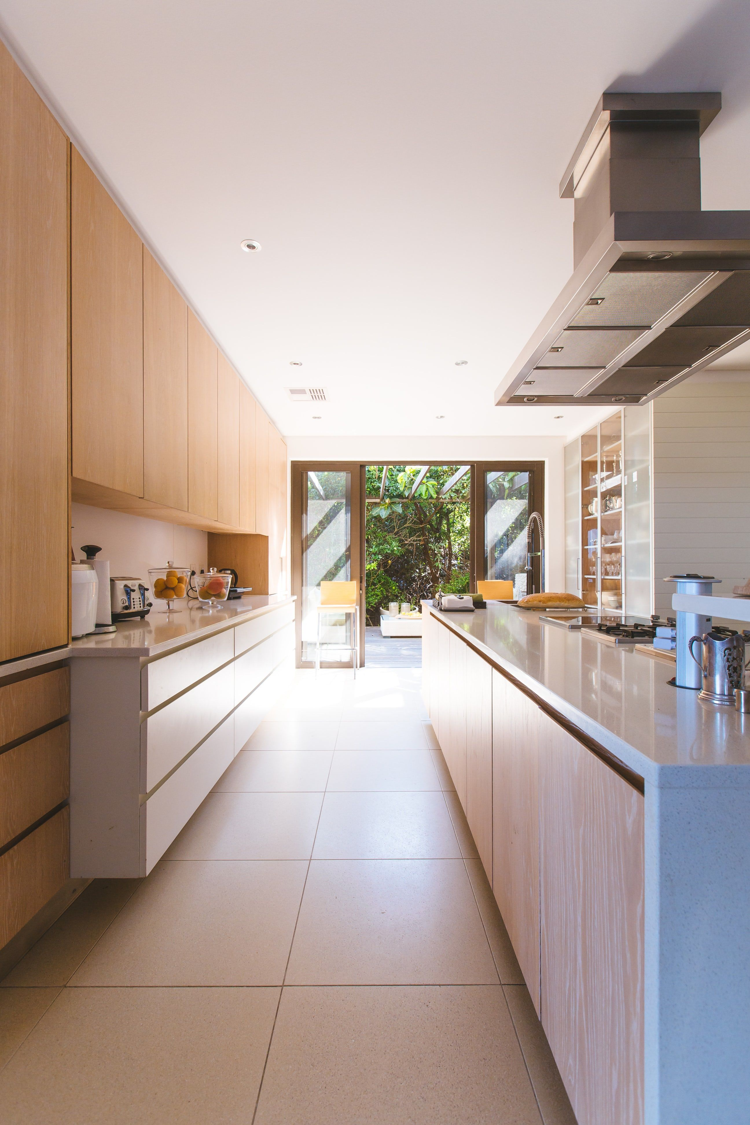 Clean Modern Kitchen With Window Looking Out On Trees And Sunlight Japanese Home Design Timber Kitchen Contemporary Kitchen