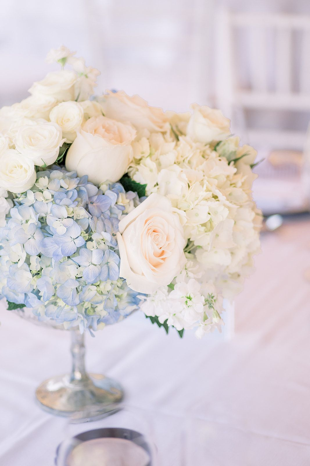 Blue And White Centerpiece Hydrangea Roses And Stock Classic Nantucket S White Hydrangea Centerpieces Blue Hydrangea Centerpieces White Rose Centerpieces