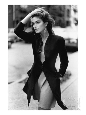 Cindy Crawford Wearing A Wool Coat Over A Slip by Arthur Elgort is part of Cindy crawford photo - Publication VogueImage Type PhotographDate February 1st, 1988Description American model Cindy Crawford wearing a wool coat over a slip dress by Ve