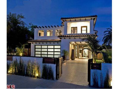 Glass Garage Door Add A Contemporary Touch To This Mediterranean Style Home Get The Look With