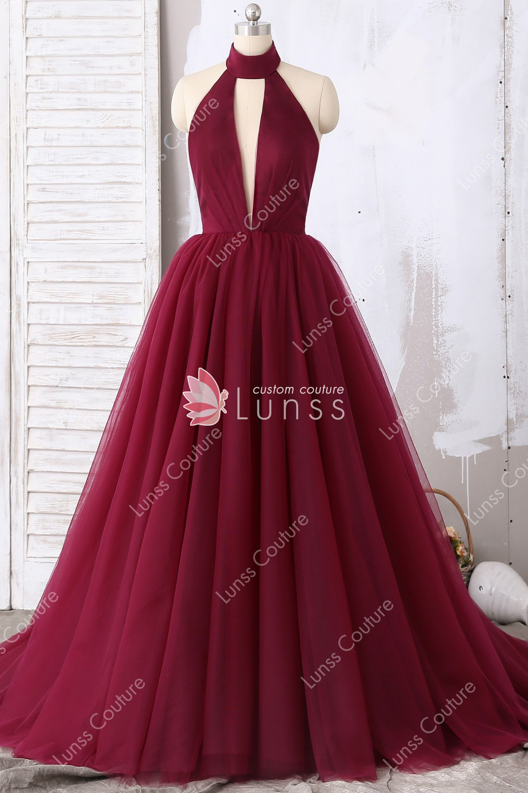 e72d69ee76 This queen style dark wine tulle puffy prom dress features timeless ball  gown silhouette, alluring high neck plunging, pleated bodice with an open  back.