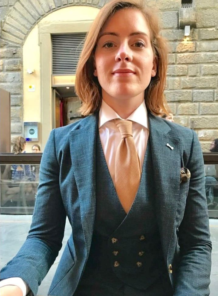 girl dressed in formal three piece suit with shirt and tie
