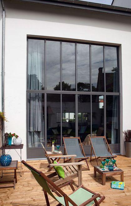 Une extansion de 130 m2 pour une petite maison de 40m2 Énergie - Terrasse Sur Pilotis Metal