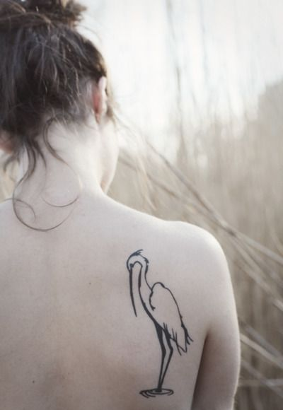 my tattoo was done in october by os at cottage 13 in hamilton, ontario. my uncle (http://www.torlukasikfoss.com/) designed it for me.  it is a stylized image of an egret. this picture means so much to me because it is a connection to my family (and their love of birds), a symbol of independence and solitude, and lastly a symbol of infinity. i love it to peices and can't wait to get another.