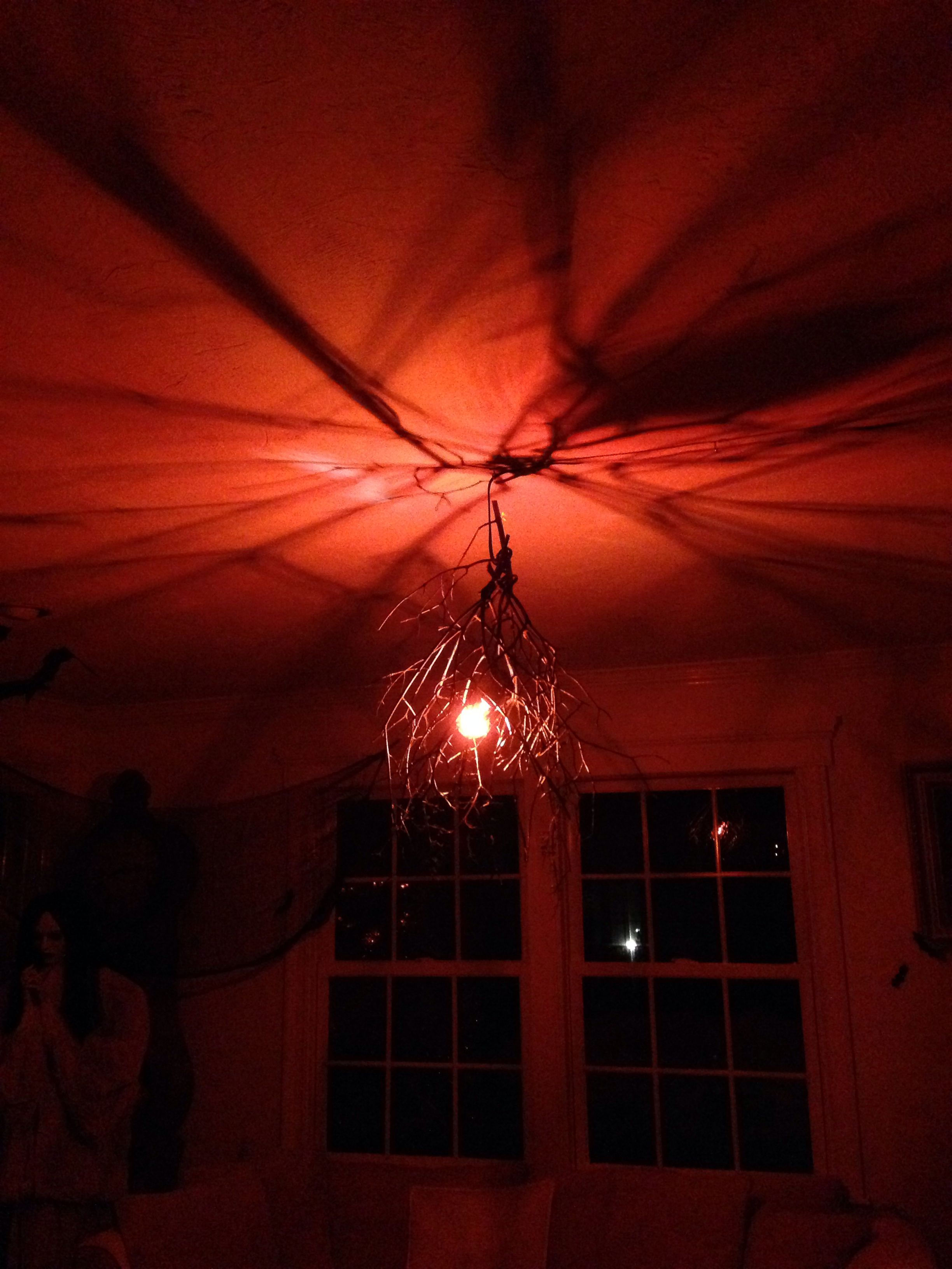 orange light bulb with some black spray painted branches easy and super spooky halloween