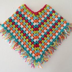 Free crochet pattern. Pattern category: Poncho. DK weight yarn. 450-600 yards. Features: Granny Square. Easy difficulty level. #babyponcho