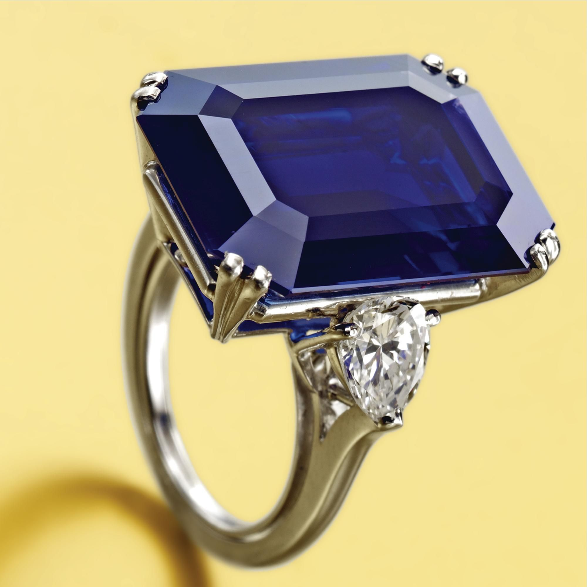 Sapphire and Diamond ring. The emerald-cut sapphire weighing 25.25 carats, flanked by 2 pear-shaped diamonds, mounted in platinum, size 5, signed Van Cleef & Arpels, maker's marks, French assay marks. Van Cleef & Arpels, Paris | Lot | Sotheby's